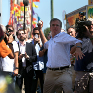 Republican presidential hopeful and former Florida Gov. Jeb Bush throws a baseball at as he plays a carnival game during the Iowa State Fair on August 14, 2015 in Des Moines, Iowa.