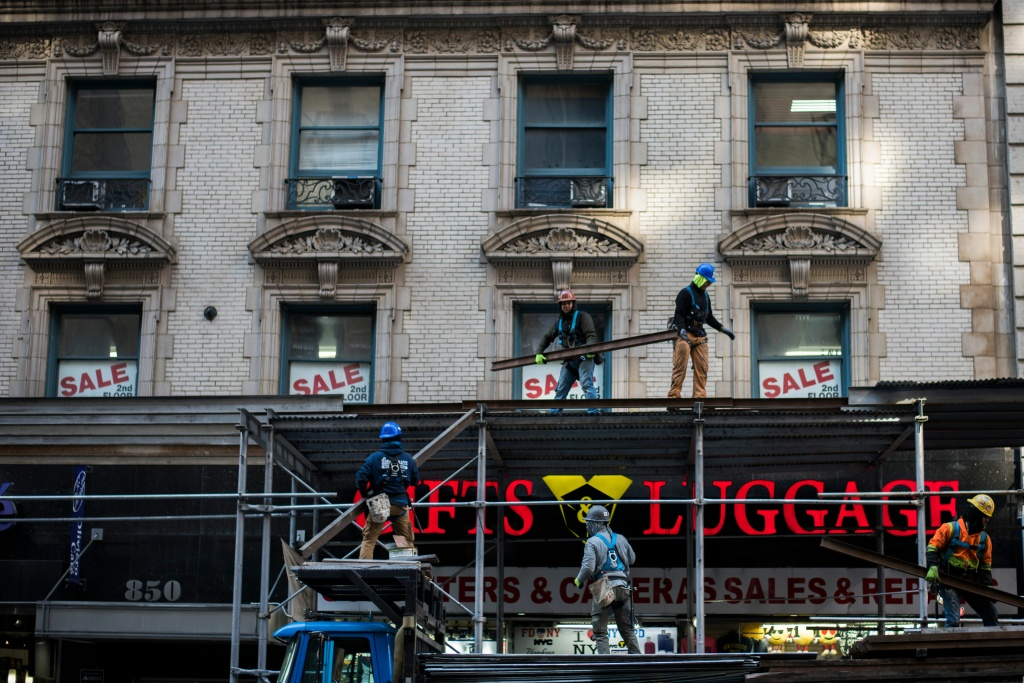 Labourers work at a construction site in New York on February 14, 2018.