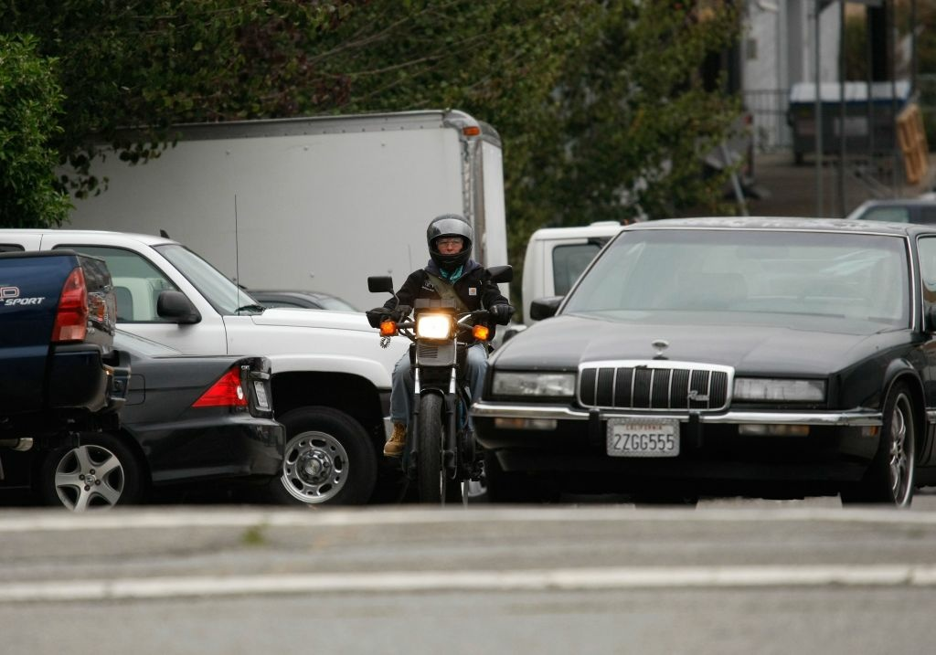 A motorcyclist is cut off by a car October 16, 2007 in San Francisco, California. Motorcycle deaths are on the rise in California with 433 deaths in 2006, up from 275 in 2000. Officials estimate that deaths are up another 8 percent this year as sales of powerful motorcycle continue on an upward trend.