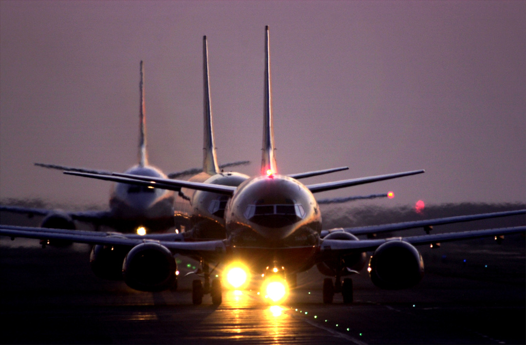File: Jets taxi after sunset June 21, 2001 at Los Angeles International Airport.