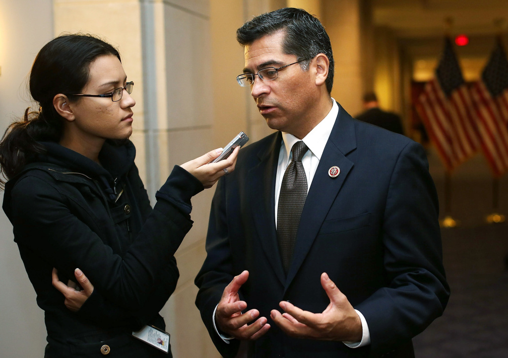 Chairman of the House Democratic Caucus Rep. Xavier Becerra (D-CA) (R) speaks to reporter after a House Democratic Caucus meeting January 15, 2013 on Capitol Hill in Washington, DC. Democratic members briefed the media on the Democratic legislative agenda for the 113th Congress, including the Disaster Relief Appropriations for victims of superstorm Sandy and tougher gun control measures.