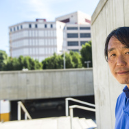 "Phillip Cho stands outisde the tower where he was incarcerated at the LASD Twin Towers Correctional Facility. Cho wrote a book about his experience in jail titled ""Twin Towers Los Angeles: A Real Life Story."""