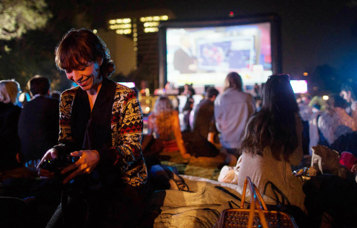 Israel Rojas of Eagle Rock follows the general election live during Park Your Politics, an election night party in Grand Park.