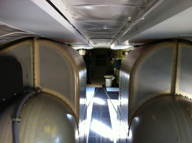 Interior, Super Scooper airplane.On the left and right are the water tanks. That's the crew toilet in the rear.