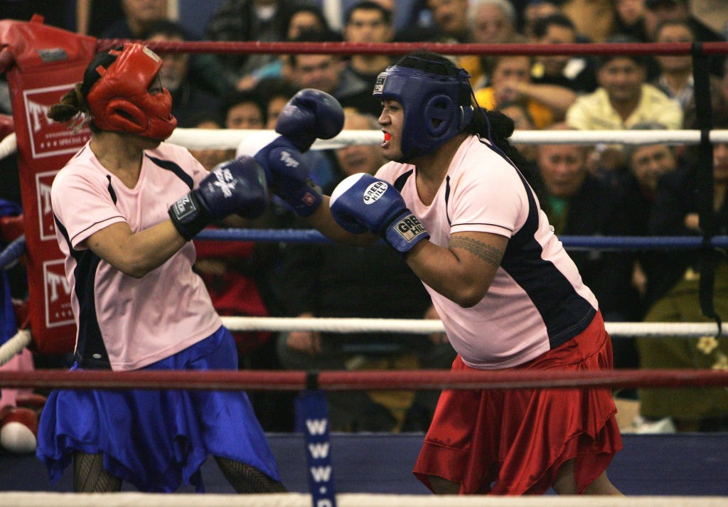 File: Queen Tisha (R) and Queen Sandra ( R) battle it out during their bout in the Last Fa'afafine Standing boxing event at Otara Recreation Centre on Aug. 14, 2007 in Auckland. A Fa'afafine is a transgender term for a Samoan boy that has been raised as a girl.