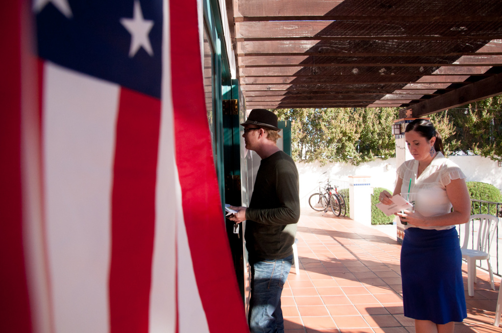 FILE: Rhys Buchele, left, and Serena Cline wait in line to vote at the George G. Golleher Alumni House at Cal State University, Fullerton, on Tuesday, Nov. 6, 2012.