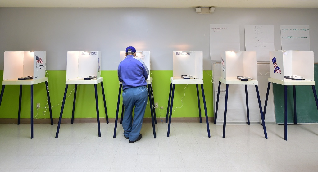 FILE: A voter casts his vote at a polling station in Pasadena, California, on Nov. 4, 2014.