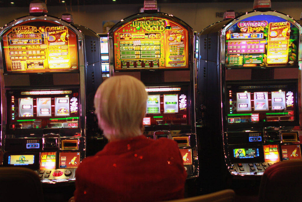 Marge Lesinski plays a slot machine during the grand opening of the newest building at the Seminole Casino Coconut Creek on December 17, 2010 in Coconut Creek, Florida.