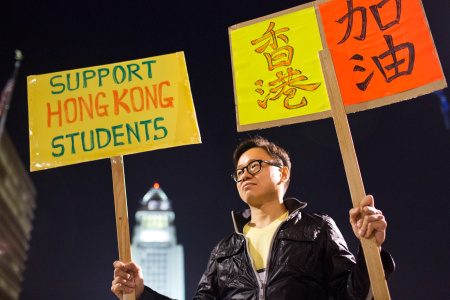 Hong Kong Forum Los Angeles organizer Donald Choy takes part during a vigil on Wednesday night, Oct. 1 at Grand Park in support of pro-democracy demonstrations happening in Hong Kong.