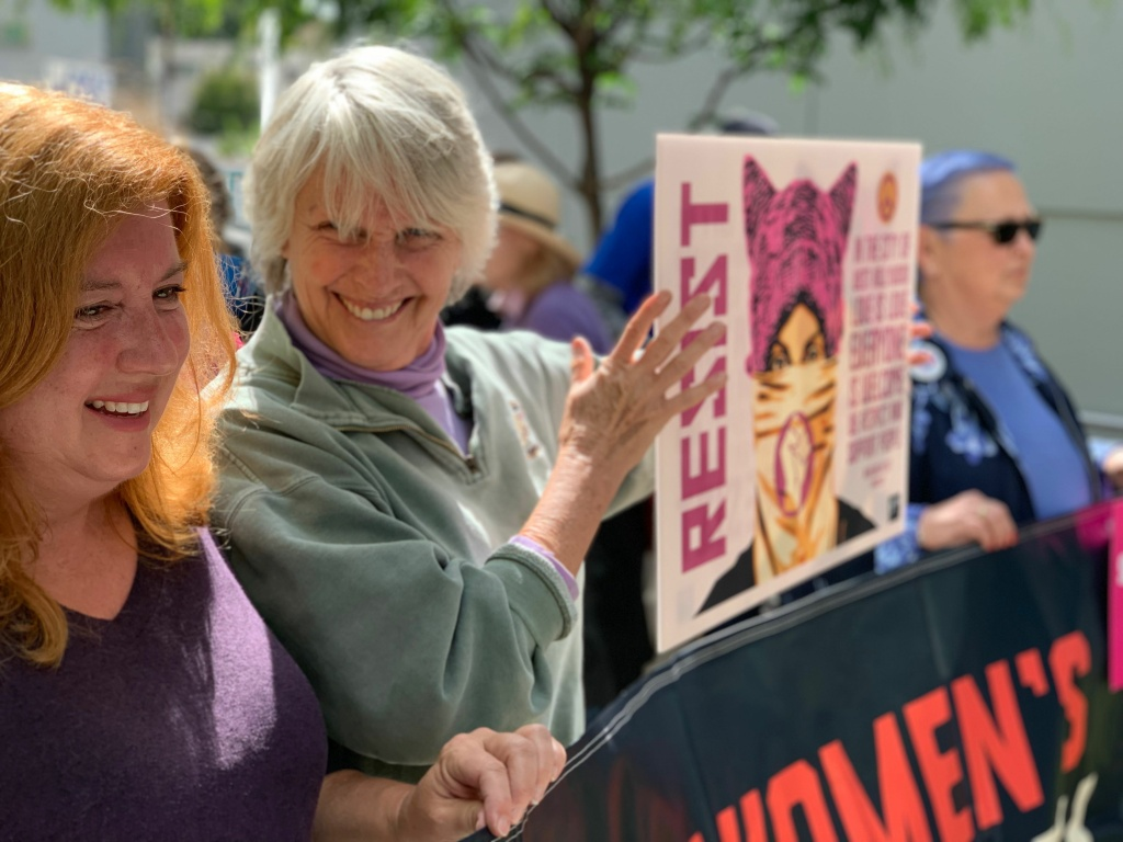 Protesters in West Hollywood held signs and cheered during the #StopTheBans rally.