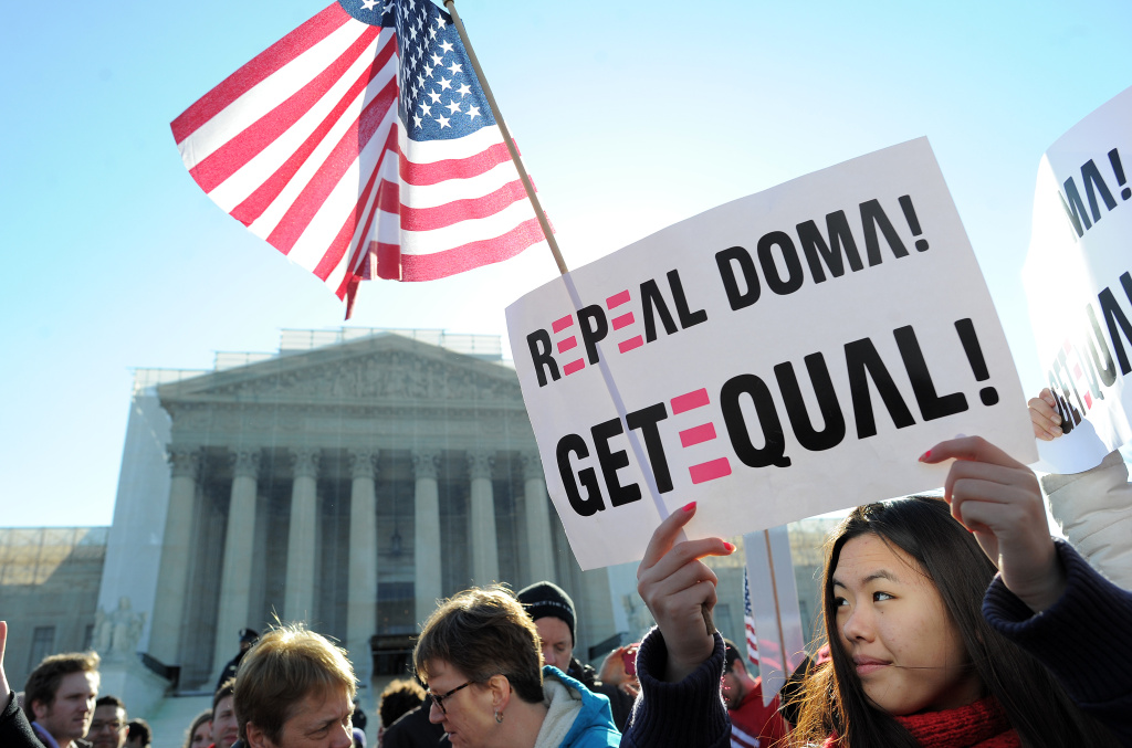 Same-sex marriage supporters demonstrated in front of the Supreme Court in March. The nine justices are expected to rule this month on the legality of the Defense of Marriage Act.