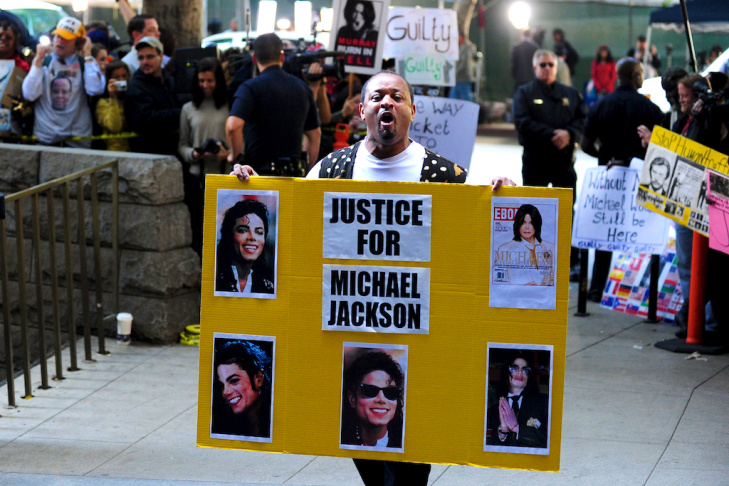 Supporters of Michael Jackson hold placards awaiting the verdict of his doctor's trial in Los Angeles on November 7, 2011 in southern California.