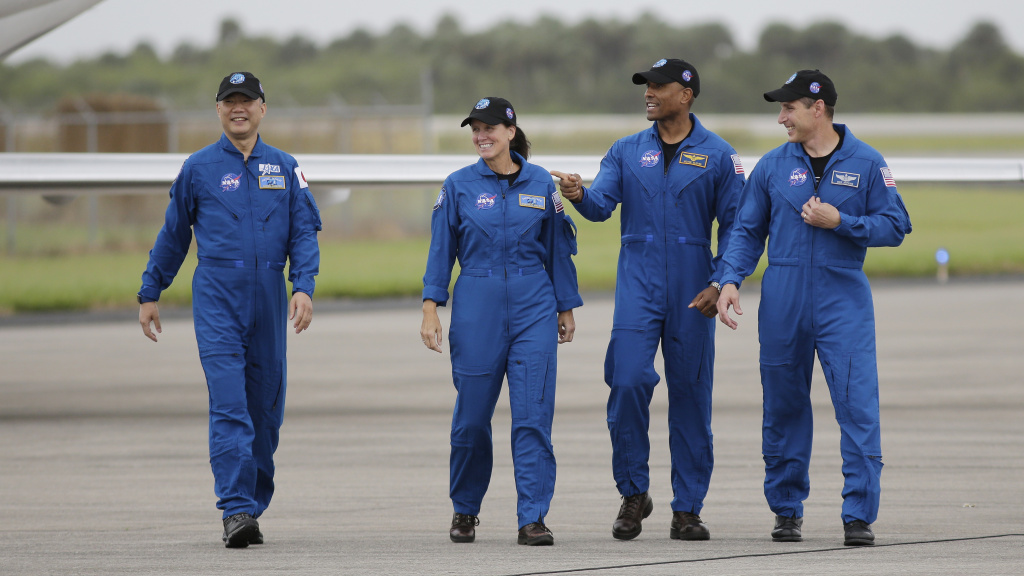 From left, astronaut Soichi Noguchi of Japan and NASA astronauts Shannon Walker, Victor Glover and Michael Hopkins walk after arriving at Kennedy Space Center in Cape Canaveral, Fla. The four astronauts will fly on the SpaceX Crew-1 mission to the International Space Station scheduled for launch on Saturday.