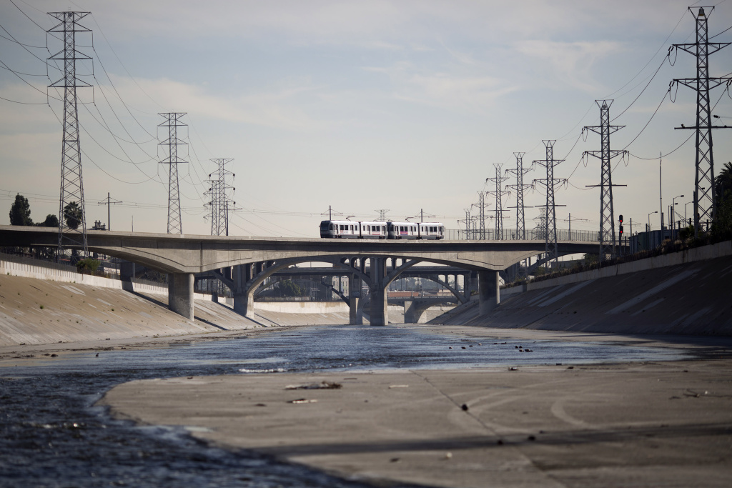 A train crosses the Los Angeles River on November 20, 2015 in Los Angeles, California.