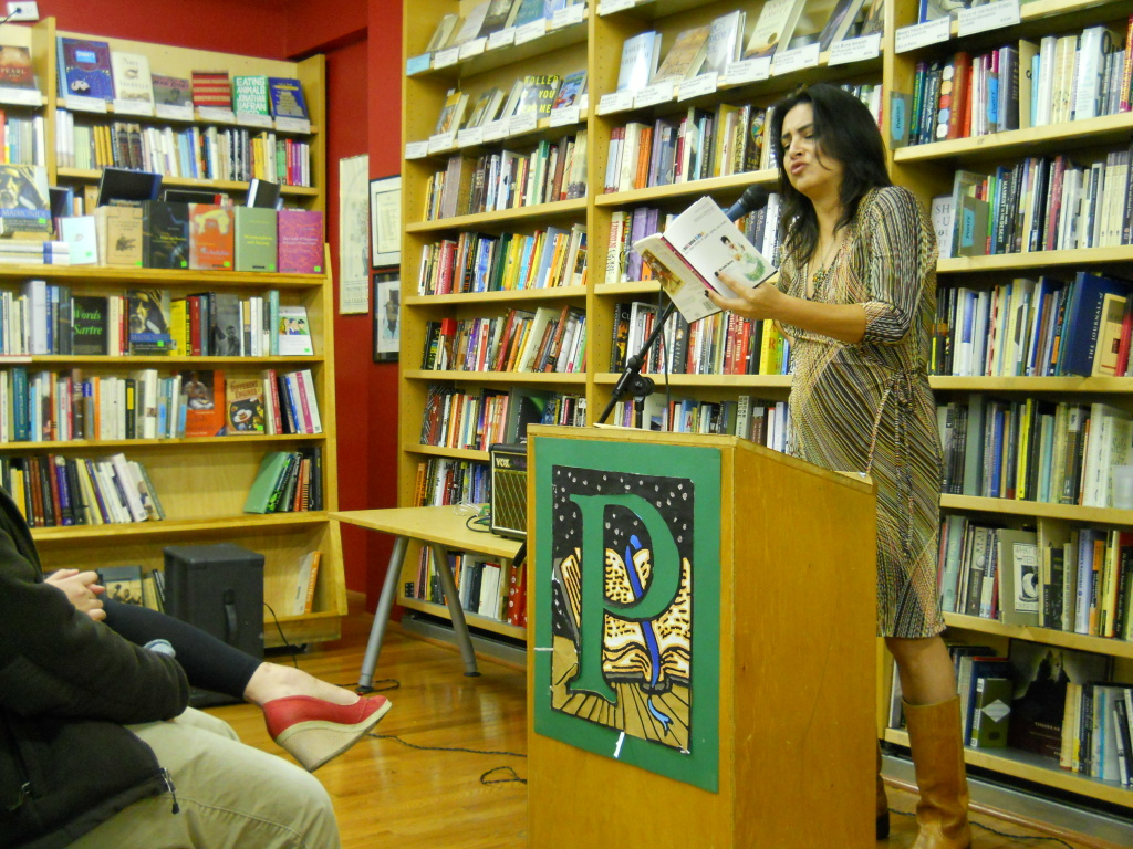 Author Michele Serros reads from one of her books at Pegasus Books in Berkeley in January 2012.