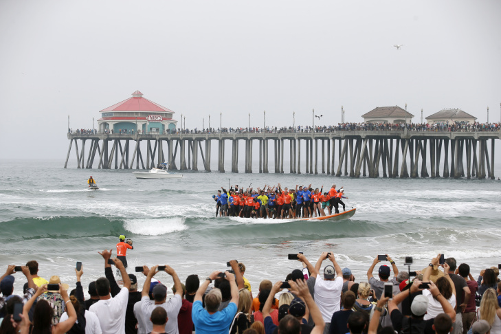 Sixty Six Surfers From Around The World Ride A Custom Built 42 Foot