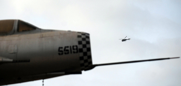 A Pakistani navy helicopter flies over a major naval air base following an attack by militants in Karachi on May 23, 2011. Taliban gunmen armed with rockets and explosives stormed a major naval air base in the heart of Pakistan's biggest city, destroying two US-made surveillance aircraft and killing 12 personnel. It was the worst assault on a military base since the army headquarters was besieged in October 2009, piling further embarrassment on the armed forces three weeks after US troops killed Osama bin Laden under their noses.