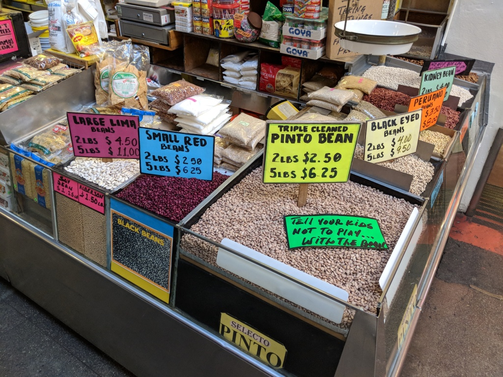 A selection of dried beans for sale at Chiles Secos, a Latino grocery stall at Grand Central Market.