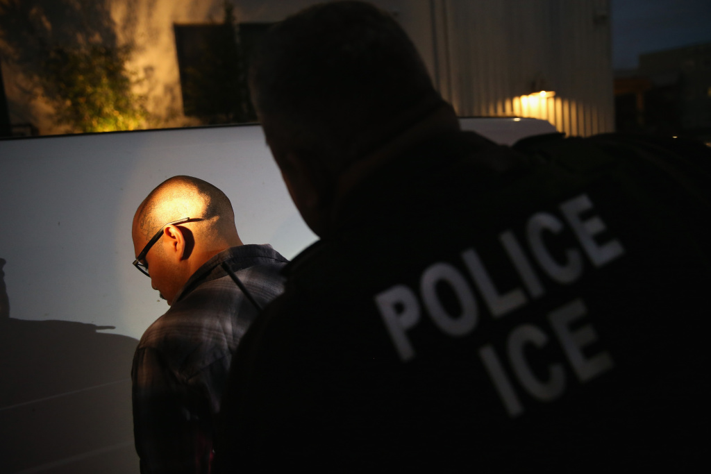 NORTHRIDGE, CA - OCTOBER 14:  In this file photo, a man is detained by Immigration and Customs Enforcement (ICE), agents early on October 14, 2015 in Los Angeles, California.