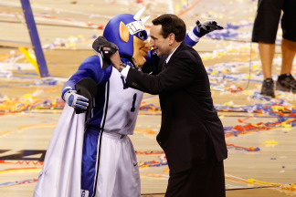 Head coach Mike Krzyzewski and the Duke Blue Devils mascot celebrate after their 61-59 win against the Butler Bulldogs during the 2010 NCAA Division I Men's Basketball National Championship game at Lucas Oil Stadium on April 5, 2010 in Indianapolis, Indiana.