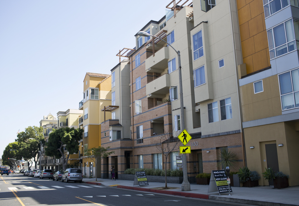 A row of five-story housing developments lines Fifth Street between Broadway and Santa Monica Boulevard. Architect Mario Fonda-Bonardi says buildings that are more than four stories tall can separate residents from the street.