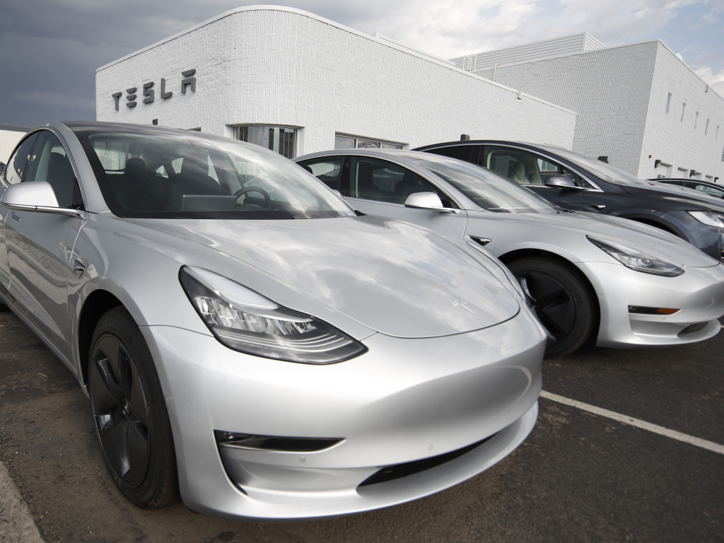 Model 3 sedans sit on display outside a Tesla showroom. For California to reach its ambitious climate change goals, every vehicle sold by 2040 in the state will have to be a zero-emissions vehicle.