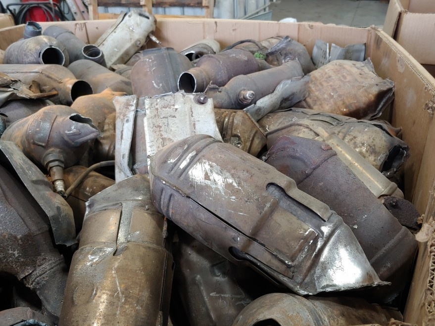 A bin full of discarded catalytic converters at AB CatTech in Burlington, Wis.
