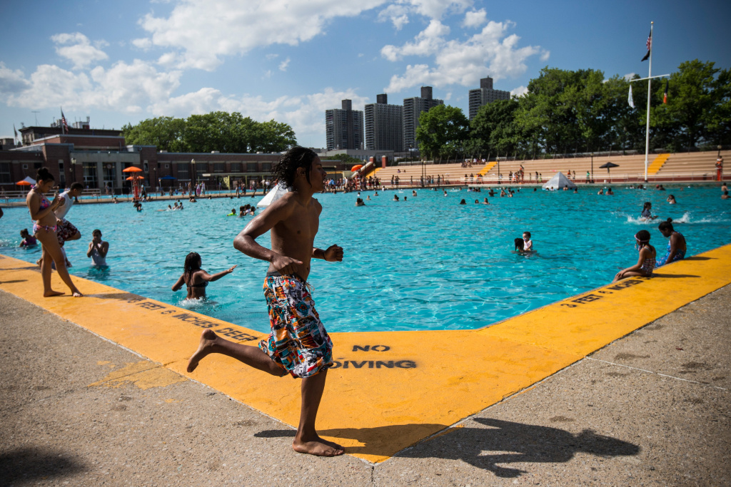 File: Children enjoy the High Bridge Park Pool at 174th Street on June 27, 2014 in the Washington Heights neighborhood of New York City.