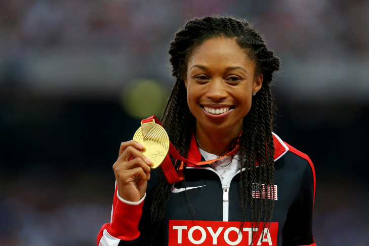 Gold medalist Allyson Felix of the United States poses on the podium during the medal ceremony for the Women's 400 metres final during day seven of the 15th IAAF World Athletics Championships Beijing 2015 at Beijing National Stadium on August 28, 2015 in Beijing, China.