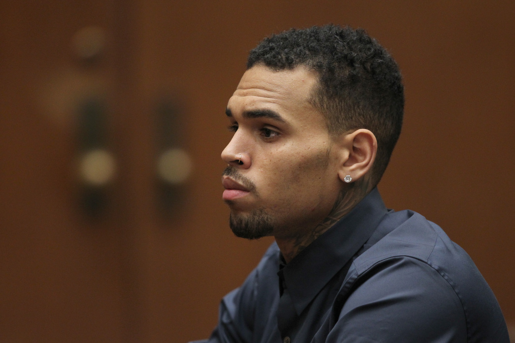 R&B singer Chris Brown appears in court for a probation progress hearing on February 3, 2014 in Los Angeles, California. Brown has been on probation since pleading guilty to assaulting his then girlfriend, singer Rihanna, after a pre-Grammy Awards party in 2009. He has been in anger management treatment program and performing community service requirements but failure to meet probation requirements could be even further complicated by assault charges he and bodyguard Christopher Hollosy face stemming from an incident outside the W hotel in Washington D.C. last October.