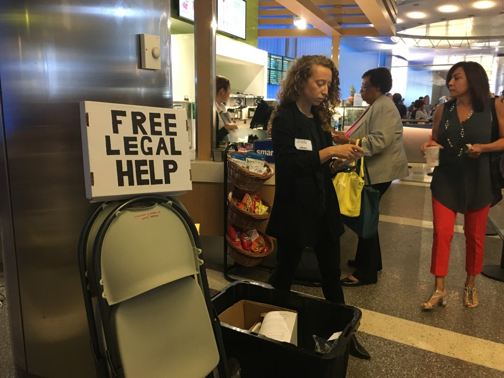Ariella Morrison with the legal advocacy group One Justice sets up in the Los Angeles International Airport overseas arrivals area on June 29, 2017.