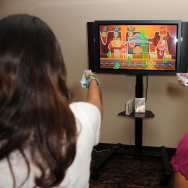 Children play Disney new video game The Princess and the Frog as they attend the video games showcase for local Miami media hosted by Disney Interactive Studios at Epic Hotel on September 17, 2009 in Miami, Florida.