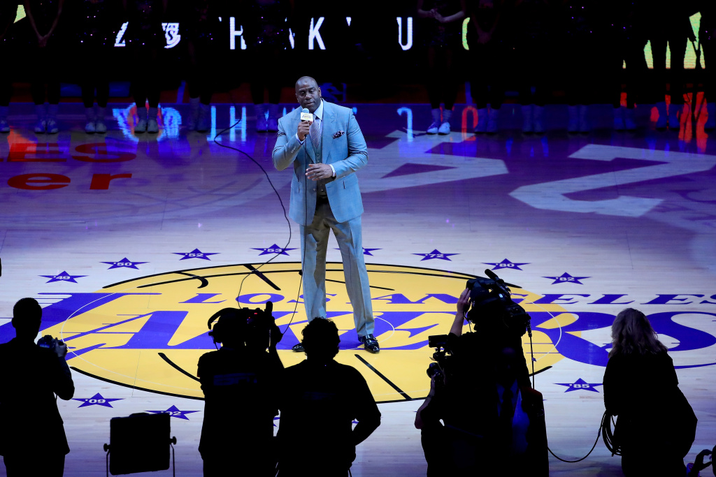 In this file photo, Earvin 'Magic' Johnson addresses the crowd as he pays tribute to Kobe Bryant #24 of the Los Angeles Lakers before Bryant plays his final NBA game at Staples Center on April 13, 2016 in Los Angeles, California. Johnson, a Hall of Fame point guard, has been appointed the Lakers' new president of basketball operations.