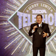 In this Sept. 2, 1990 file photo, entertainer Jerry Lewis makes his opening remarks at the 25th Anniversary of the Jerry Lewis MDA Labor Day Telethon fundraiser in Los Angeles.