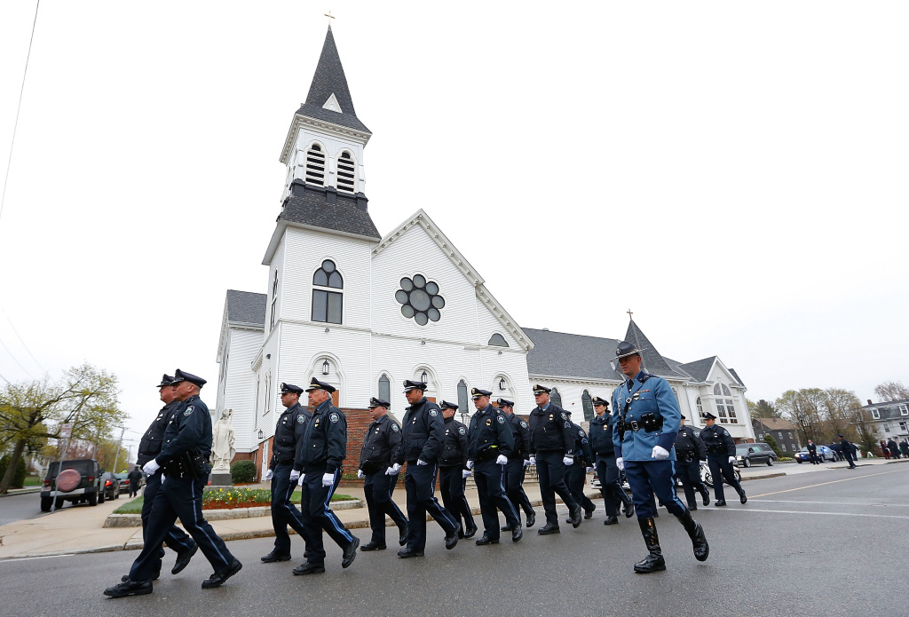 Massachusetts State Police officers walk in formation during the funeral procession for the slain Massachusetts Institute of Technology (MIT) police officer Sean Collier at St. Patrick's Church on April 23, 2013 in Stoneham, Massachusetts.