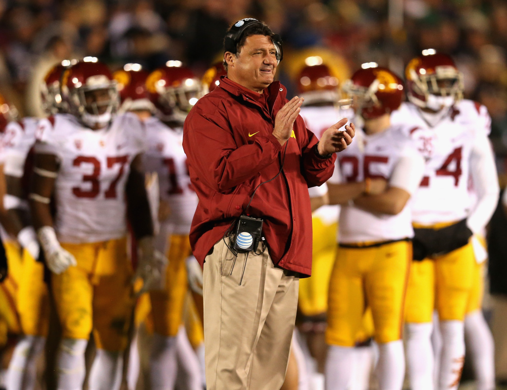 Interim head coach Ed Orgeron of the University of Southern California Trojans watches as his team takes on the Notre Dame Fighting Irish at Notre Dame Stadium on October 19, 2013 in South Bend, Indiana. Notre Dame defeated USC 14-10.