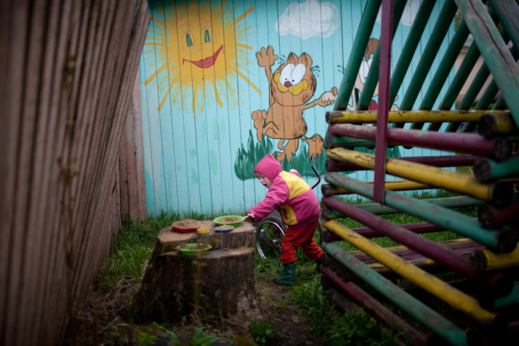 Oxana, an orphan at the Nelidovo Rehabilitation Center for Children and Youth with Disabilities in Russia, puts together a puzzle. Russia recently banned U.S. parents from adopting orphans like Oxana.