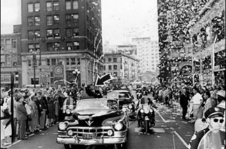 A waving Stevenson in the Los Angeles ticker tape parade at Eighth and Spring streets.
