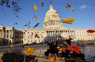 Leaves are blown off the plaza of the U.S. Capitol.