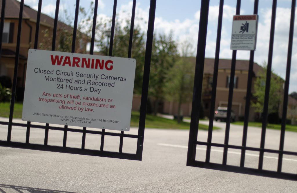 A security gate stands in front of The Retreat at Twin Lakes gated community where Trayvon Martin was shot and killed by George Michael Zimmerman while on neighborhood watch patrol on March 28, 2012 in Sanford, Florida.