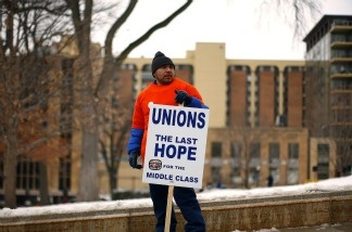 A protester outside the Wisconsin State Capitol February 22, 2011. With state Democrats still in hiding over the legislation proposed by the Governor to restrict collective bargaining for public workers, Republicans threatened to move on without them.