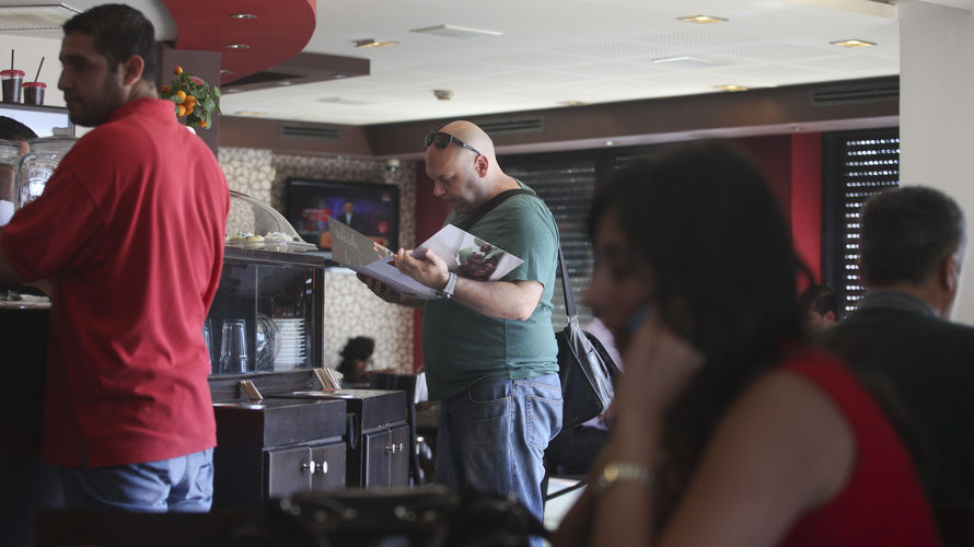 Palestinians order food at a coffee shop in the West Bank city of Ramallah on Sunday.