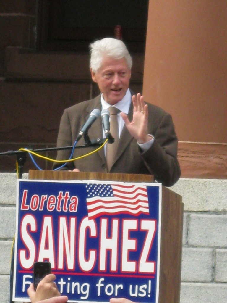 Former President Bill Clinton speaks at a campaign rally for Democratic Congresswoman Loretta Sanchez outside the Old Orange County Courthouse in Santa Ana this afternoon.