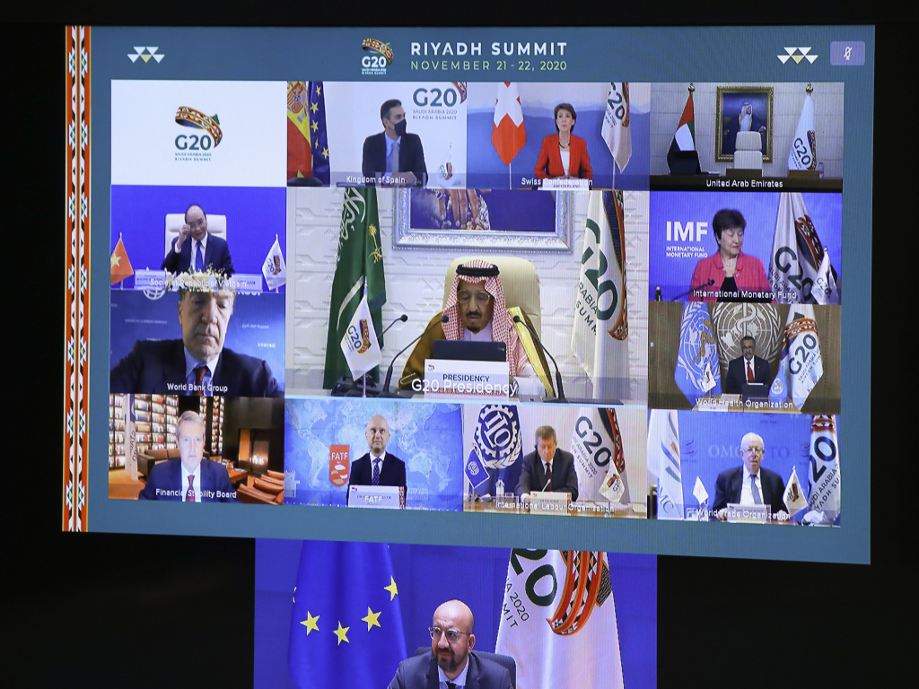 European Council President Charles Michel, on screen bottom, participates in a virtual G-20 meeting, hosted by Saudi Arabia, at the European Council building in Brussels on Saturday.