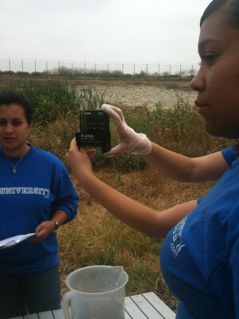 High schoolers in the water education program called Aqua University and ambassadors for the Conservation Corps at the L.A. River demonstrate water quality testing. EPA's announcement means the L.A. River must meet strict Clean Water Act standards.