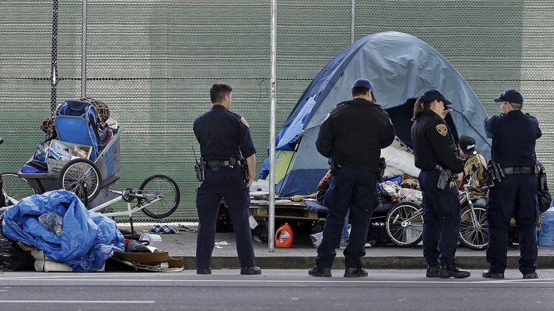 Police at a homeless encampment in San Francisco