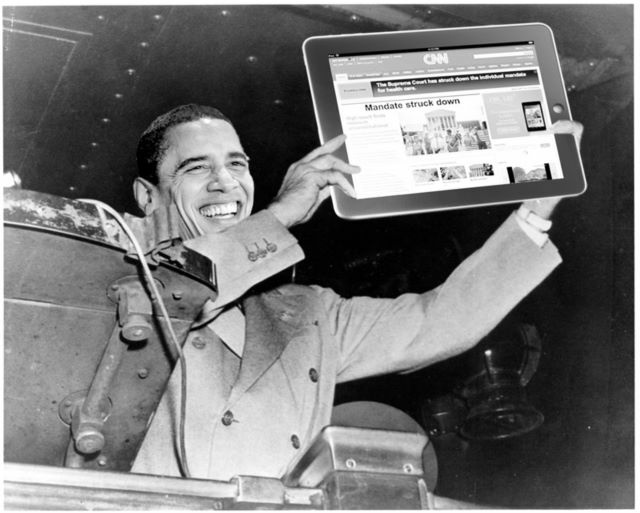 Barack Obama looking at CNN on his iPad.