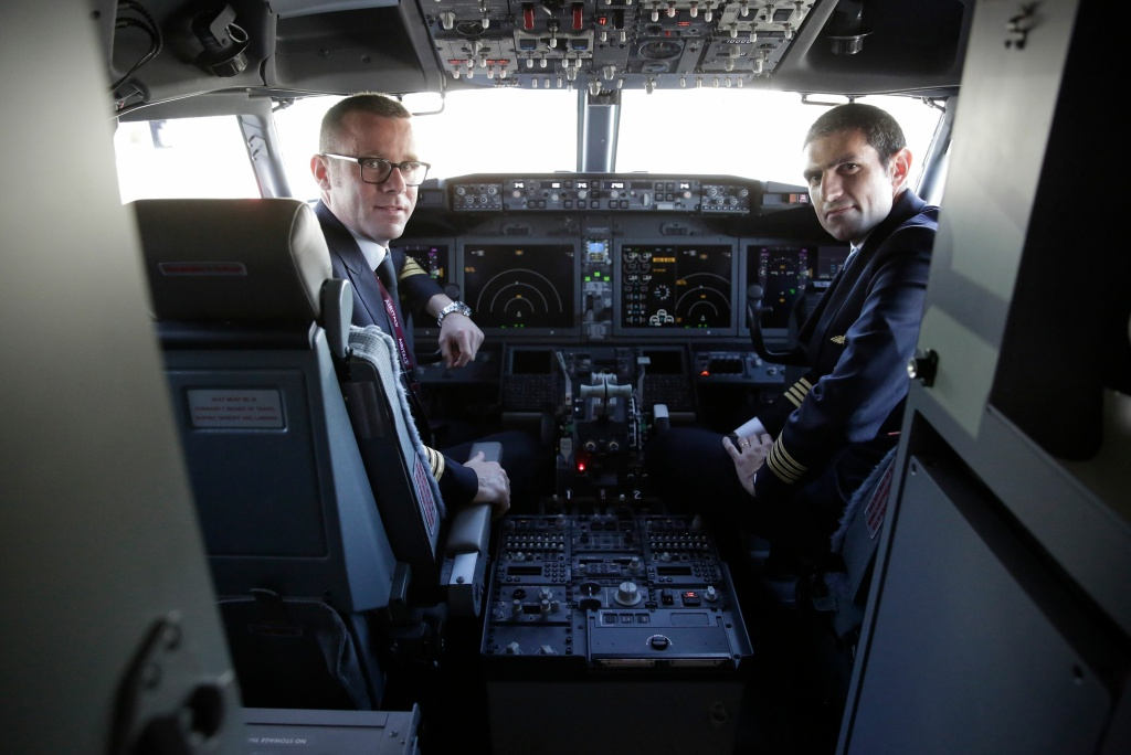 Pilots are pose inside the cockpit of a Boeing 737 MAX 8 as Boeing Commercial Airplanes, Qatar Airways and Air Italy celebrate the delivery of their first 737 MAX in Everett, Washington on May 11, 2018.