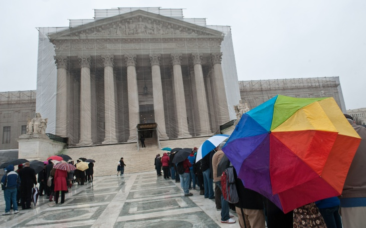 Supporters and opponents of same sex marriage gather in front of the U.S. Supreme Court on Tuesday, March 26 before oral arguments on the legality of California's Prop 8.