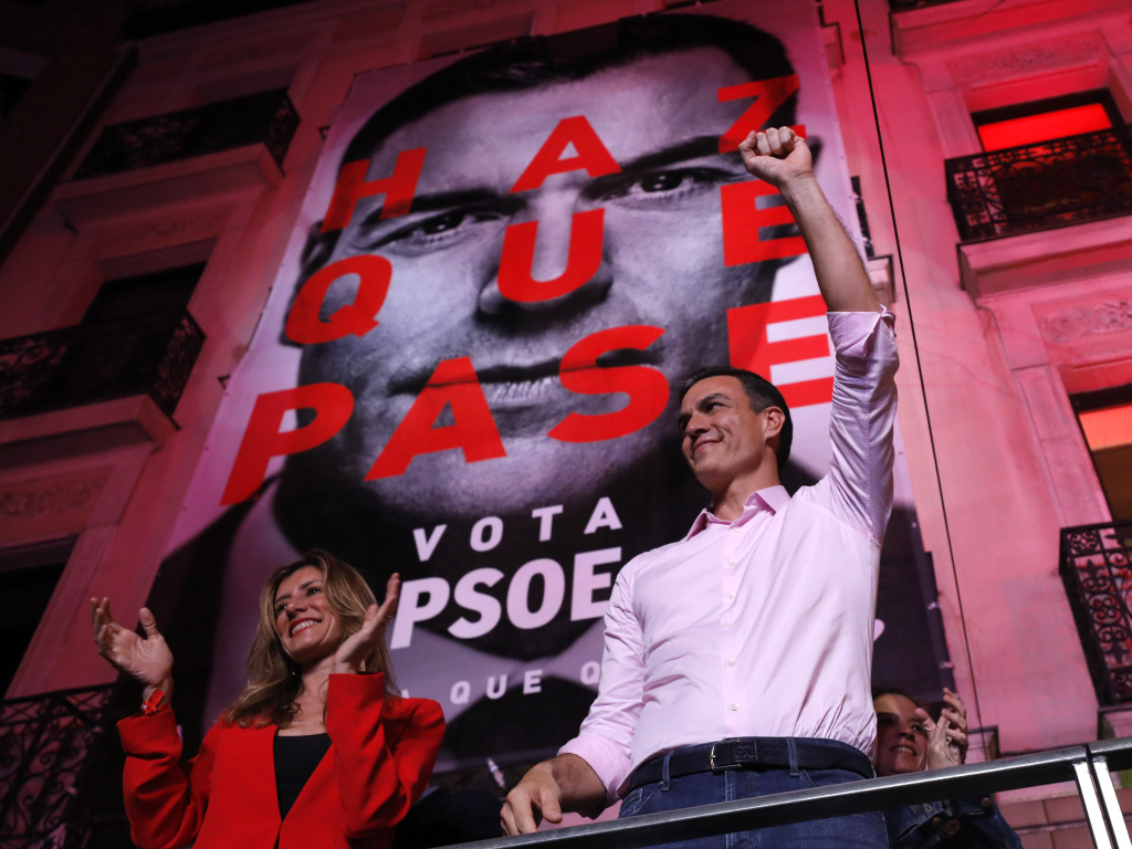Spain's Prime Minister and Socialist Party leader Pedro Sanchez gestures to supporters outside the party headquarters following the general election in Madrid on Sunday.